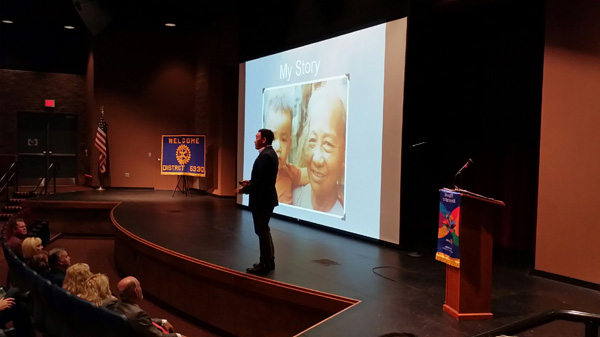 Toan Lam speaking at Rotary International event